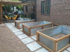 Concrete pavers and galvanized raised beds