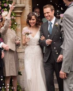 Nat (Rose Byrne) wears a shimmering Gatsby-esque sheath with sheer sleeves by Charlotte Walter for the wedding in the 2013 film, later topping it with her husband's suit jacket.