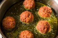 bake mine on a cookie sheet at 375, turning once or twice for even browning. Two things I swear by are: (1) meatloaf mix - the combination of beef, veal and pork makes for a very tender, flavorful meatball and (2) I use the Rao's trick of slowly adding a cup or so of lukewarm water to the mix. At first, the water/meat mixture looks kind of gross and very loose, but the panko/breadcrumbs soak up the water and you end up with the most delicious, delicately-textured-yet-hearty meatballs EVER!