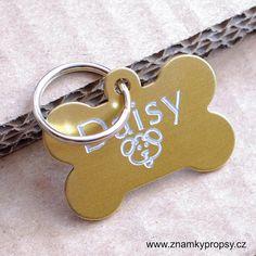 Zlatá kostička je psí známka z eloxovaného hliníku, na kterou si od nás můžete nechat vyrýt jméno psa, symbol a na zadní stranu kontakt - telefon, adresu, číslo čipu apod.