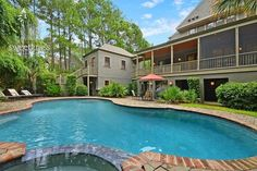 222 Fish Hawk - Kiawah Island. 10 foot ceilings, oak flooring and walls of windows. Come spend your vacation in this amazing 4 bedroom house! It even has its own private pool!! #KiawahIsland #SweetgrassProperties #vacation