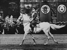 Marshal Georgy Zhukov, riding a Terek light-gray stallion named Idol, gallops past troops on parade during  Victory Day in Moscow on June 24, 1945. Legend has it that Stalin allowed Zhukov to take the salute because he, Stalin, was afraid he could fall off the horse because he was a poor rider.