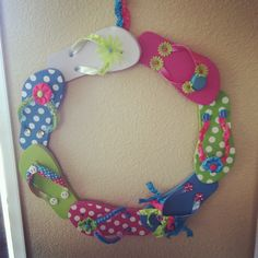 flip flop wreath. Use smaller kiddie flip flops, and decorate. glue foot to heel with hot glue. hot glue decorations on. Hang with ribbon. cute!