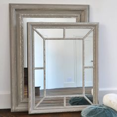 A stylish panelled mirror in a beautiful distressed wooden frame.This elegant mirror will look lovely in a hallway or lounge hung over a console table or sideboard. The wooden frame has been painted with a blue-grey finish which has been lightly distressed for an aged appearance. A wonderful example of a window mirror. Fixes with D rings which we recommend are hung over sturdy screws (not supplied) to hold the weight.Wooden Frame.Height: 100cm x Width: 80cm.