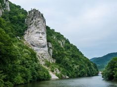 This rock sculpture of the face of Decebalus, Dacia's last king, is carved on a jagged outcrop of the Danube River near the city of Orsova in Romania. The 131 foot high carving is the tallest rock sculpture in Europe. Danube River, River Thames, Italian Sculptors, Rock Sculpture, Cradle Of Civilization, Yangon, Insta Photo, Roman Empire, Montenegro