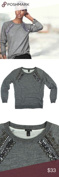 """JCREW Charcoal Gray Jeweled Raglan Sweatshirt Top Excellent condition! This charcoal gray jeweled raglan sweat shirt from JCREW features accent jeweled detail by the neckline, long sleeves and a crew neckline. Made of a cotton blend. Measures: Bust: 35"""", total length: 22.5"""", sleeves:23"""" J. Crew Tops Sweatshirts & Hoodies"""