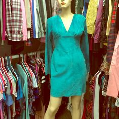Teal suede stunner vintage dress Gorgeous cut open back great vintage dress!! Due for a cleaning and priced to sell it's killer on too busty for me pic accurate color in last pics shoulder to shoulder 16 1-2, pit pit 15 1/2in- 13in waist 33 1/2 inches long Vintage Dresses