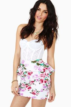 I love this! Not a huge fan of floral usually, but it looks great with the lace bustier. Plus I dig peplums :)