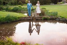 Beautiful sunset bride and groom portrait. Reflections in the pool at Preston court. Blue suit, short wedding dress. Creative wedding photography