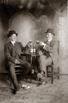 Portrait of Two men drinking Louis Obert Gold Beer. (1910)