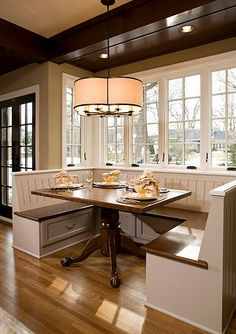 Create a #kitchen /dining room #design with a #Built-In #Dining #Room #Bench and #Table to create a #breakfast #nook - Dura Supreme #Cabinetry designed by Ispiri.