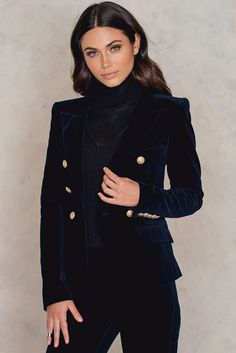 Blow everyone's mind in this killer blazer! This Reba Blazer by Hunky Dory comes in navy velvet fabric and features a classic blazer style, one left side chest pocket, two front mid waist pockets, golden button details at front and at sleeves. Style with matching byron flares for that ultimat look!