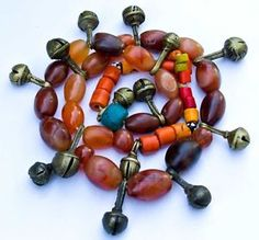 Spectacular antique tribal necklace dating from the late 19th to early 20th century originating from Nagaland composed of beautiful carnelian stone beads and bronze bell ornaments with wonderful patina. The necklace measures 27 inches in length.  $379.