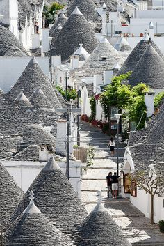 Row of trullo houses in Alberobello, Bari, Italy