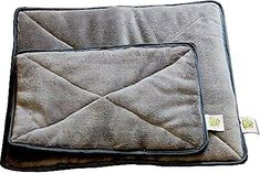 Give your kitty something warm to cozy up to with Pet Magasin's Thermal Self-Heated Cat Bed! This thermal pet bed includes a layer of super-insulating Mylar film that absorbs, holds and reflects your pet's body heat while insulating and protecting them from cold floors. An ultra-comfortable velvety cover provides the perfect soft surface for your little one to nestle into on cold nights. Plus, thick hypoallergenic foam is guaranteed to stay springy for years to come—perfect for older pets…
