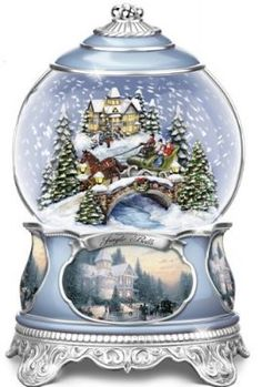 "Celebrate the joys of Christmas with this sparkling Christmas musical snowglobe, only from The Bradford Exchange Exquisitely handcrafted of artists' resin and meticulously hand-painted, this stunning Thomas Kinkade snowglobe features a fully-sculpted winter scene inspired by the Painter of Light?? From the cobblestone bridge and one-horse open sleigh to the inviting Thomas Kinkade-style house, this keepsake captures the essence of the beloved song, ""Jingle Bells"""