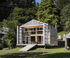 A notional shed on a jetty was the inspiration for this impressive bach above a beach on Kawau Island. Sam Caradus of Crosson Architects discusses the build Wooden Ramp, Sliding Door Panels, Beachfront Property, Exterior Cladding, House And Home Magazine, House Tours, Interior Architecture, Shed, Outdoor Structures
