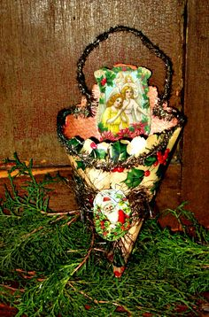 Antique scrap and tinsel paper candy container.
