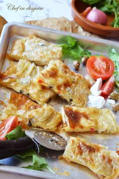 Egyptian cheese fteer or feteerFlaky layered pastry,crackling with every bite, irresistibly decadent no matter what the filling is Lebanese Recipes, Turkish Recipes, Ethnic Recipes, Persian Recipes, Middle East Food, Middle Eastern Recipes, Comida Armenia, Egyptian Food, Egyptian Recipes