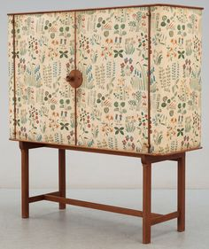 Josef Frank, mahogany cabinet covered in Frank's floral chintz fabric 'Fatima', c1937.
