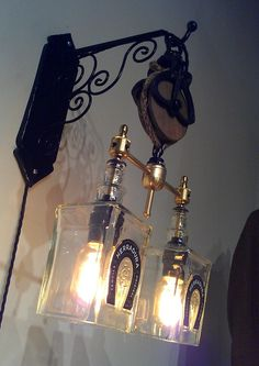 Recycled Wine Bottle Liquor Bottle Hanging Pendant Sconce Steampunk Chandelier with Pulley. $379.00, via Etsy.