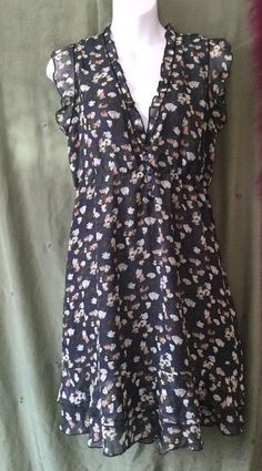 """Purple, L size dress. Chiffon with sweet pea floral pattern. Lightly elasticated just under the bust. Lined. Armpit to armpit 21"""", it's wide because it's gathered. Shoulder to hem 40"""" In good , hardly used condition. 