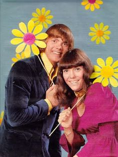 THE CARPENTERS, brother and sister duet who were very famous in the 60s.  They turned out hit after hit.  I still love their music and listen to it often.    Every Christmas I still hear their Christmas album playing everywhere.  Karen Carpenter died very young of complications from an eating disorder.