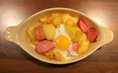 Extremely easy and tasty quick supper. German smoked sausage, sauteed potatoes and onions with a baked egg.