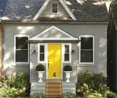 Love the bright yellow door on the grey house . I have always wanted a front door that stands out so I can tell people - turn down fourth street and I'm the house with the bright yellow door! Fall Paint Colors, Paint Colors For Home, Yellow Front Doors, Front Door Colors, Roof Colors, Exterior Paint Colors For House, Exterior Colors, Exterior Gris, Bungalow Exterior