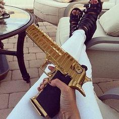 Girl holding a gold Gun Weapons Guns, Guns And Ammo, Bad Girl Aesthetic, Aesthetic Grunge, Gun Aesthetic, Revolver, Mexican Drug Lord, Big Girl Toys, Drug Cartel