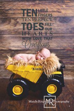 Newborn boy portraits // nude, caramel brown fur, Tonka dump truck // Client's home - travelling studio - Geneva, IL // Mandy Ringe Photography