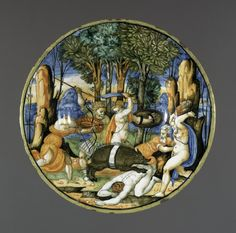 Plate with well and foot-ring. Earthenware covered front and back with presumed tin glaze. Painted decoration shows a landscape with a group of men attacking the Calydonian boar; the boar, which has a white band around its middle, is itself leaping on a crouching man. The rim painted yellow.