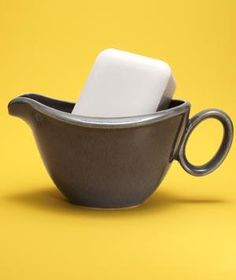 Fill an antique gravy boat with a bar of soap to transform it into an elegant soap dish.