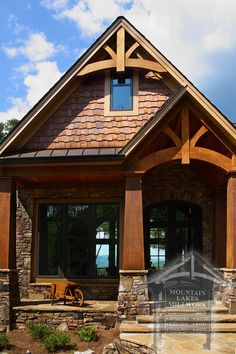 wood siding and stacked stone and cedar shake
