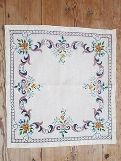 Lovely floral embroidered tablecloth in good condition, spotless. The size is: 18 x 17 The material is linen, cottonthread International shipping Contact me if you have questions Also offer combined shipping and refunding shipping overages Thank you for visit my vintage shop :)