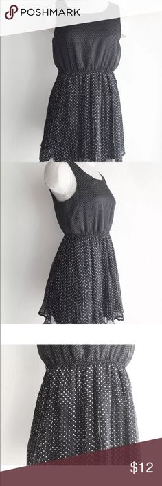 """Forever 21 Navy Blue Polka Dot Dress Forever 21 Navy Blue Dress White Polka Dot Pleated Skirt Sleeveless Semi Sheer M  Measurements: Taken Flat  Sleeve Length: Sleeveless.  Shoulders (Measured across the back, shoulder seam to shoulder seam)- 12""""  Bust (Arm pit to arm pit X 2)- 36""""  Waist- 26"""" Has elastic, stretches to about 36""""  Length (Shoulder Seam to bottom hem)- 32""""  Looks great, no holes or tears. No belt.  Bin#10 Forever 21 Dresses"""