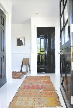 Briggs Edward Solomon Love the white walls and black doors White Painted Floors, Painted Doors, White Walls, White Ceiling, Floor Design, House Design, Porches, Interior Exterior, Interior Doors
