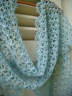 How lovely is this delicate lacy crochet scarf! Includes link to the free pattern