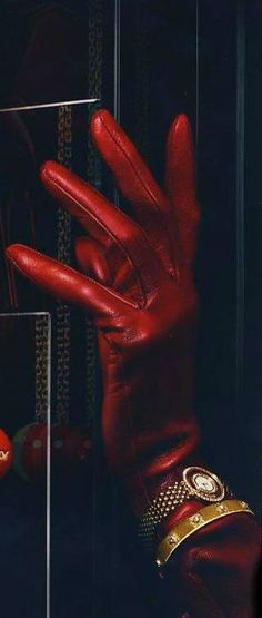 red gloves (right glove with attachments) [or only on right hand, having knit wingerless gloves on both hands]