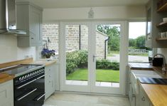 French doors with flag windows finished in Off-White with a Satin Chrome Windsor handle and manufactured in Engineered European Redwood Bi Folding Doors Kitchen, Kitchen Patio Doors, Open Plan Kitchen Living Room, Home Decor Kitchen, Interior Design Kitchen, Kitchen Extension With Bifold Doors, Interior Ideas, Kitchen Ideas, Small Open Plan Kitchens