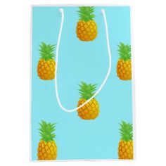 Pineapple Pattern on Blue Medium Gift Bag A repetitive pattern of simple pineapples on a bright blue background. This is a cute and summery pattern perfect for many occasions.