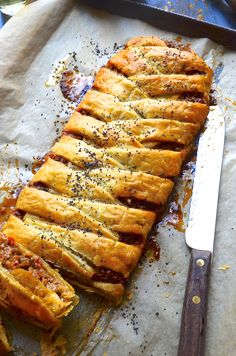 Spicy Mexican meat and Manchego cheese plait with poppy seed puff pastry crust