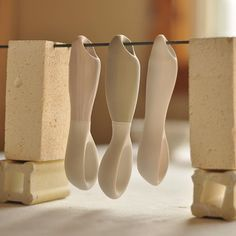 Add holes in the spoon handles to hang fire