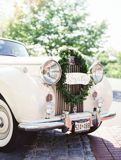 #transportation, #wreath  Photography: Erich McVey Photography - erichmcvey.com  Read More: http://www.stylemepretty.com/2014/05/01/oh-so-classic-nautical-wedding/