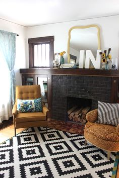 Fireplace redo...Could work in living room...extend mantel and add cabinet on either side under windows.