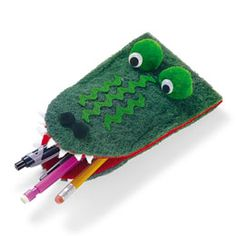 gator pencil holder- he kinda looks ike he's urping them up, though