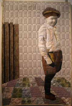 Tone Haugen-Cogburn's quilt depicts her father when he was 5 years old. She used fabric from her father's actual clothing, and his face is reproduced from an old snapshot photocopied onto a piece of cloth.  Tone's Textile Art : Maryville College show