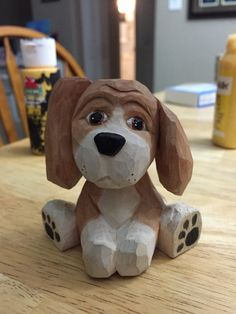 This beagle pup was hand carved from basswood and painted with acrylics. A must-have for any hound dog enthusiast! Dimension are approximately 3 tall with a 2x2 base.