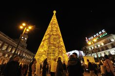 Instead of the typical tree lighting experience, Puerta del Sol square hosts a LED-lit tree, switching on this sparkling display during the Christmas season.     - CountryLiving.com