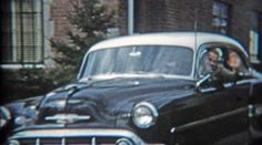 1953: Dad showing off new car pulling into driveway. http://www.pond5.com/stock-footage/55314627?ref=StockFilm keywords:dad, show, car, driveway, oldsmobile, chevy, house, visit, backup, return, static, cleveland, ohio, usa, 1953, 1950s, 8mm, super8, 16mm, film, old, home movie, vintage, retro, news, tv, archive, nostalgia, memories, throwback, Americana, documentary, editorial, historic, professional, capture, grainy, preserve, restore, reality, classic, era, priceless, politics, elders…